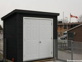 Black Sarawak shed 6x10 with metal double doors in Etobicoke, Ontario. ID number 176702.