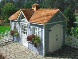 Blue Canexel Palmerston shed 8x14 with cedar shingles in Rolling Green, California. ID number 527.
