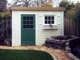 Cedar Sarawak shed 6x10 with arched single door in Madison, Wisconsin. ID number 5773.