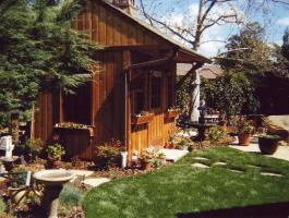 Cedar Glen Echo Shed 8 x 10 with antique flower boxes and arched single door in Thousand Oak, California. ID number 8110.