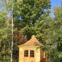Cedar Melbourne Shed 10 x 10 with double arched doors in Traverse City, Missouri. ID number 42626-7