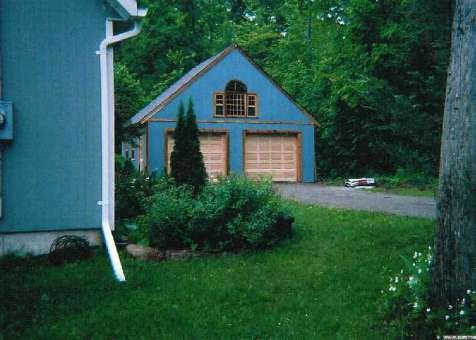 York garage designs 24x24 with fan arch window in Mississauga,Ontario.ID number 1252-1.