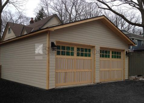 Cedar highlands garage with coach style garage door and large opening sash window in Toronto, Onta