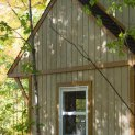Prefab Bala bunkie 10 x 10 with rough cedar siding in Mckellar Ontario. ID number 194930-6