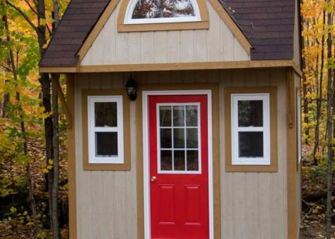Prefab Bala bunkie 10 x 10 with rough cedar siding in Mckellar Ontario. ID number 194930-7