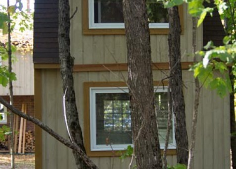 Prefab Bala bunkie 10 x 10 with rough cedar siding in Mckellar Ontario. ID number 194930-8