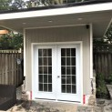 Canexel Mist Grey Verana 8x8 garden shed with metal double doors in North York Ontario. ID number 23