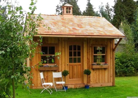 Cedar Glen Echo Shed 10 x 14 with cedar shingles in Hassendeanburn Scotland. ID number 1439-1