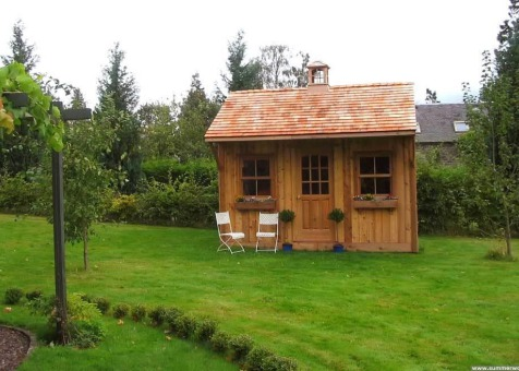 Cedar Glen Echo Shed 10 x 14 with cedar shingles in Hassendeanburn Scotland. ID number 1439-3
