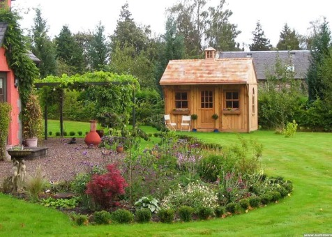 Cedar Glen Echo Shed 10 x 14 with cedar shingles in Hassendeanburn Scotland. ID number 1439-4