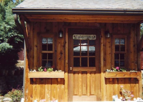 Cedar Glen Echo Shed 8 x 10 with antique flower boxes and arched single door in Thousand Oak Califor
