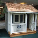 Peach pickers porch 7x7 playhouse with ss1 storm shutters Oshawa Ontario.ID number 5494-1.