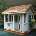 Peach pickers porch 7x7 playhouse with ss1 storm shutters Oshawa Ontario.ID number 5494-2.