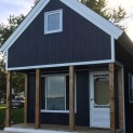 Cheyenne cabin 14x20 with Canexel Midnight Blue siding in Carrying Place Ontario. ID number 194261-1