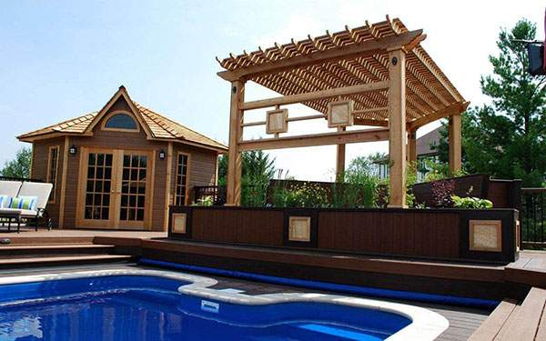 Stunning poolside covered sitting area and trellis. ID number 115604